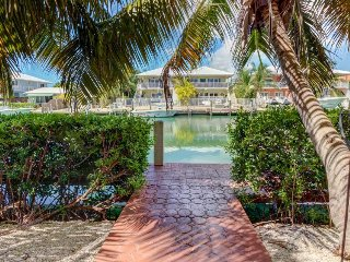 Waterfront home w/ a 35-foot dock & access to shared pool and beach!