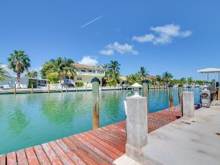Dog-friendly waterfront home w/35-ft dock, shared pool, hot tub, & Cabana Club!