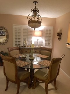 dining room area with new chandelier and dining table