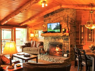 Family Room with wood burning fireplace.  Wall of windows to view the Smokies. We supply wood.
