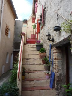 External staircase to La Cachette and the terrace at the front of the house.