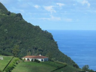 Hillside location with views of both ocean and mountains.