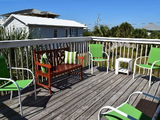 The deck off of the main level living area gets lots of sun and is a great place to enjoy the outdoors.