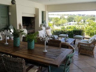 The patio is a private space with a fireplace and a beautiful view