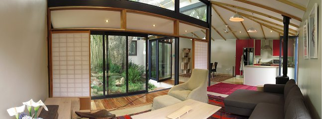 Living room with garden and fountain view.Double volume ceilings and Japanese Shoji doors