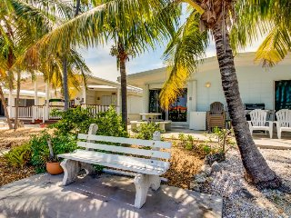 Waterfront rental w/ shaded patio, shared pool, 35-ft dock - close to golf