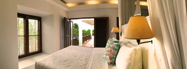 The Poolside Master Suite is in its own building for ultimate privacy and opens onto the pool