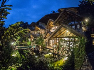 Avalon Ubud Carved out of Mountain Suite Master Bedroom  Garden & Fish pond View