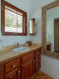 The Guest Suite features an en-suite bathroom with indoor and outdoor shower