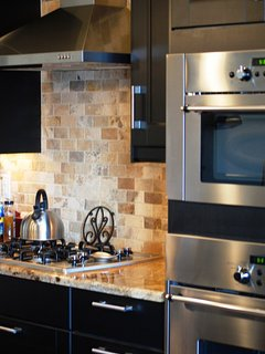 Custom kitchen with stainless appliances