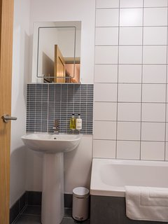 Bathroom with illuminated mirror.