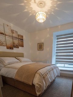 Bedroom with double bed and fully fitted luxury wardrobes.