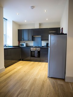 Fully fitted kitchen equipped with everything needed to prepare, cook and serve a meal.
