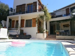 Modern villa, private heated pool, short walk to beach, shops and bars.