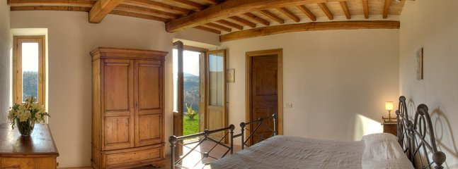 King size bedroom with ensute bathroom with shower. French door to the garden overlooking the valley