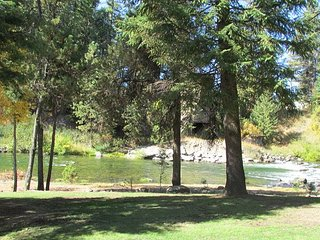 Spacious Condo on Payette River and walking distance to the lake.