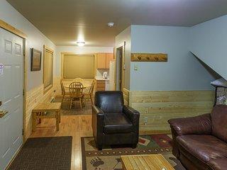 Living room, half bathroom, and dining area
