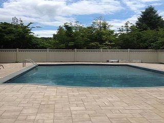Beautiful four BR Southampton home with a large pool and a jacuzzi.