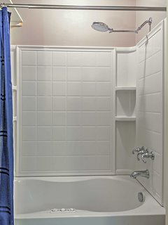 Take your time washing off in the spacious bathtub/shower combo.