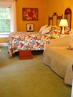 The Sugar Creek View Room. ! queen, 1 twin  overlooks front entry & creek. Shares bath with 1 room.