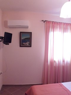 AC in the bedroom with the double bed