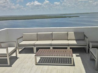 Furniture on the bay side on the big terrace.