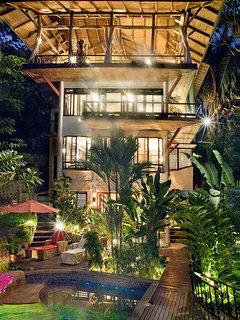 A great night time shot of the Casa Vista Azul lit up.