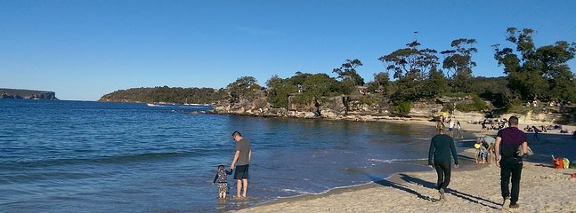 View of Balmoral Beach with North and South  heads in Sydney Harbour