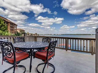 Lovely lakefront townhome boasting private dock and two decks!
