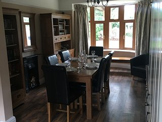Dining area with extending table to seat 10. Selection of DVDs, books and games