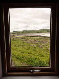 Bedroom with a view over sandy Ettrick Bay