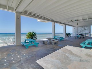 Beachfront studio w/ private beach access, shared pool, large deck & more!