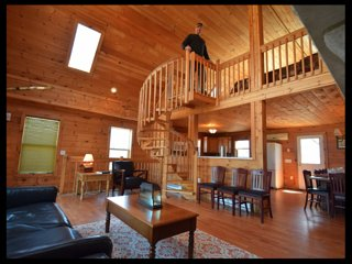 Amazing 4 Story log home with deck 40' high.  See every star in the sky!