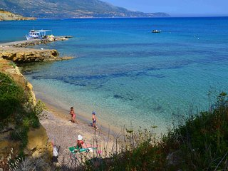 Your children will be happy to play in the soft sand and swim in shallow waters of Spartia beach!