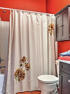 Rinse off in the shower, decorated with a floral curtain, and come out smelling fresh as a spring flower!