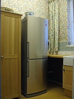 Rear pantry - full facilities including washing machine, drier and sink