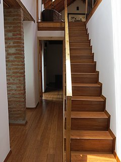 Staircase and on the left, the door to bedroom No 1