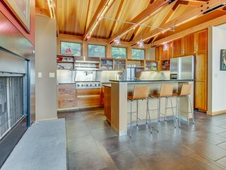 Spacious bayfront home boasts easy beach access and a private sauna!