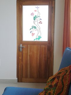 Mango House Vizag: Solid teak door with stained glass styling to your own private balcony