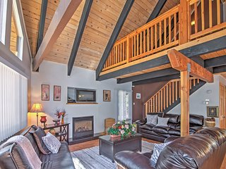 Unwind in the expansive living area with a warm fireplace glowing as you watch TV.