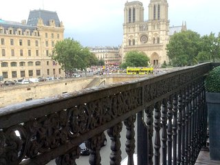 Balcony + River & Notre Dame Views  2 Free Cruises