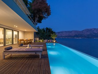 Unique beachfront villa with fantastic views over the Ionian Sea and its islands