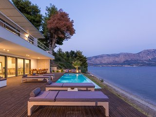 BEACHFRONT villa with fantastic views over the Ionian Sea and its islands