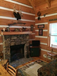 Sassafras Rock living area with beautiful stone masonry fireplace.  Wood is available in Dillard.