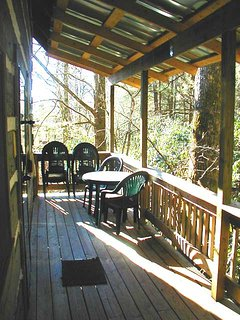 The back porch overlooks beautiful Betty Creek and has a grill & table and chairs for dining.
