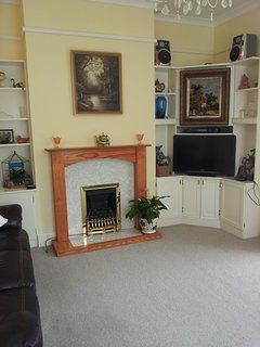 lounge with gas fire,tv,settees and french windows to front terrace