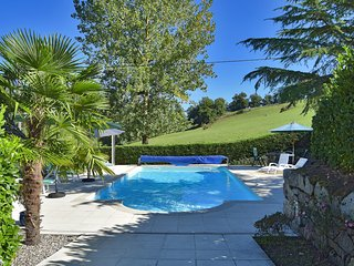 The fenced and gated pool with large terrace, dining area, beds, umbrellas and lovely views
