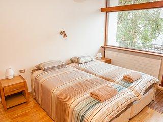 Master bedroom with balcony towards garden