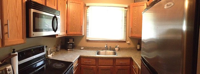 Cute kitchen with lots of counter space and dishwasher