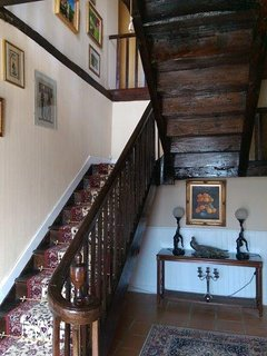 Entrance hall with original oak staircase